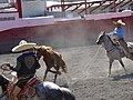 Mexican charro forefooting on horseback.jpg