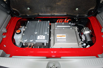 Mitsubishi i-MiEV - Mitsubishi i MiEV. Under the rear load platform. The inverter, rectifier and DC-DC voltage reduction device (For auxiliary battery). The motor, differential and reduction gear assembly are beneath. On the left, the red filler cap is for motor coolant (water antifreeze mix). On the right, the electric vacuum pump for the braking system.
