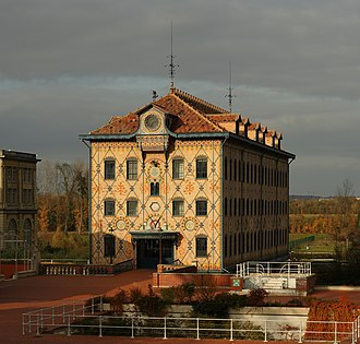 Industrial architecture - The Moulin Saulnier, originally a watermill, now part of the Menier chocolate factory in Noisiel, France. Built in 1872, it was the first building in the world with a visible metallic structure.