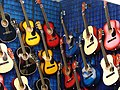Multi coloured acoustic guitars.jpg