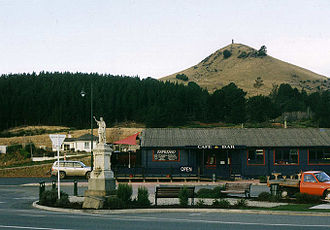 Palmerston, New Zealand - Puketapu dominates Palmerston, New Zealand. The statue at left depicts Zealandia.