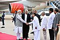 Narendra Modi being received by the Prime Minister of the Democratic Socialist Republic of Sri Lanka, Mr. Ranil Wickremesinghe and other dignitaries, on his arrival at Bandaranaike International Airport, in Colombo, Sri Lanka.jpg