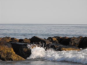Narragansett, Rhode Island - Waves crashing on a rock in the Atlantic Ocean, visible from the Seawall of Narragansett.