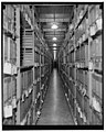 National Archives. Washington, D.C., Nov. 22. After processing the documents, they are placed in file. This is the Division of War Department Archives LCCN2016876653.jpg