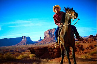 Indigenous peoples of the Americas - A Navajo man on horseback in Monument valley, Arizona, United States