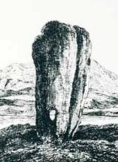 A black and white line drawing of a tall standing stone that is wider at the top than the base. It has a long vertical crack on the right-hand side and there is a small hole that goes right through it near the ground. A lake and hill are in the background.