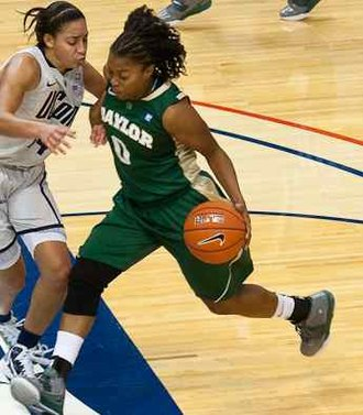 Big 12 Conference Women's Basketball Player of the Year - Baylor's Odyssey Sims (with ball) won the Wade Trophy along with the Big 12 award in 2014.