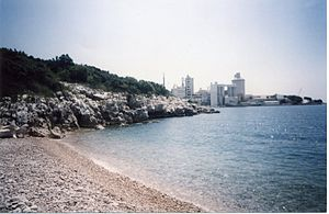 Koromačno - Overlooking the cement factory and port Koromačno from Pripogni beach