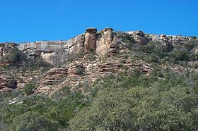 A photo of the Packsaddle Mountain cliff face