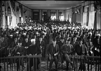 "Mandatory Palestine - An Arab ""protest gathering"" in session, in the Rawdat el Maaref hall, 1929. From left to right : unknown – Amin al-Husayni – Musa al-Husayni – Raghib al-Nashashibi – unknown"