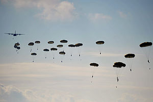 Exercise Joint Warrior - British paratroopers from 3 PARA descend following a drop by a French Air Force C-160 Transall during Exercise Joint Warrior 12/1