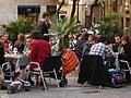 People enjoying the Spanish lifestyle in a café (4481388070).jpg