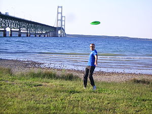 Frisbee - Someone throwing a flying disc