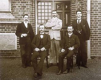 Perth Observatory - Observatory staff, c.1900. The first Government Astronomer, W. Ernest Cooke is seated at the left. His successor Harold Curlewis, is standing in the light coloured suit.