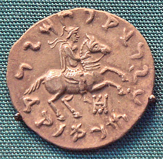 "Philoxenus Anicetus - Coin of Philoxenus, making a blessing gesture with his right hand. Kharoshti legend MAHARAJASA APADIHATASA PHILASINASA ""Invincible King Philoxenus"". British Museum."