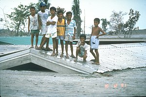 Bamban, Tarlac - Children on roof of a school in Bamban, that was buried by lahars during the 1991 eruption of Mt. Pinatubo.