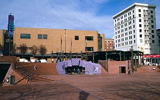 Pioneer Courthouse Square - A 1986 view, showing the fountain's original color and a banner for Powell's Travel Store