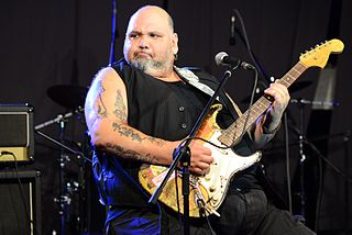 Popa Chubby American electric blues singer, songwriter, and guitarist
