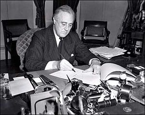 1941 in the United States - March 11: President Franklin D. Roosevelt signs the Lend-Lease Act