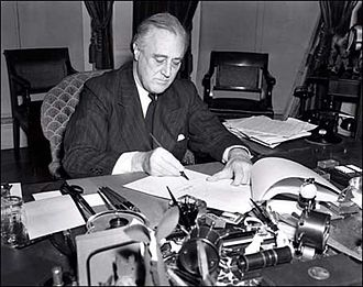 Lend-Lease - President Roosevelt signs the Lend-Lease bill to give aid to Britain and China (1941).
