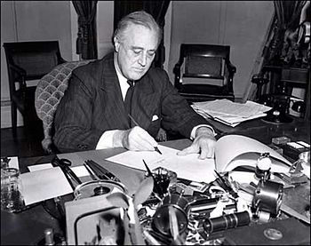 U.S. President Franklin D. Roosevelt signs the...