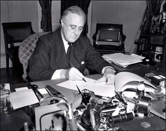 U.S. President Franklin D. Roosevelt signs the Lend-Lease bill to give aid to Britain and China (1941). President Franklin D. Roosevelt-1941.jpg