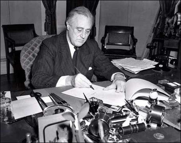 President Roosevelt signs the Lend-Lease bill to give aid to Britain and China (1941). President Franklin D. Roosevelt-1941.jpg