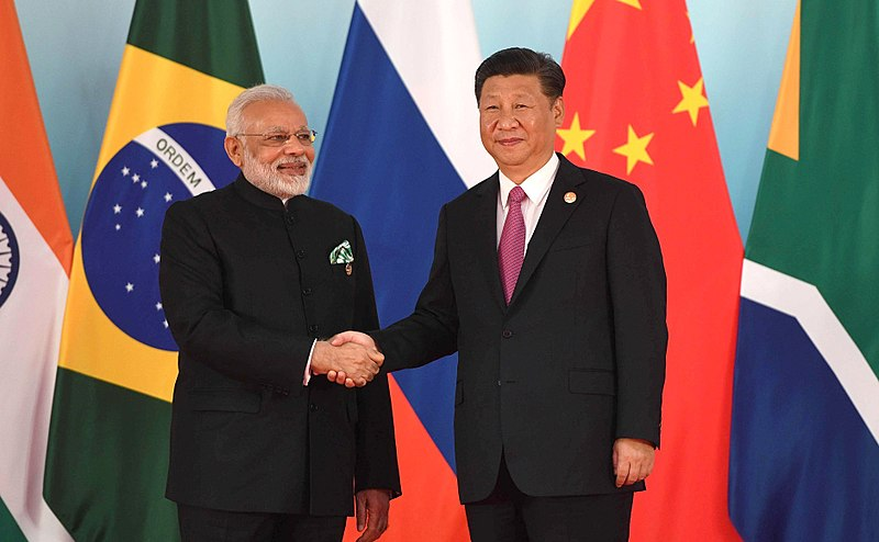 File:Prime Minister of India Narendra Modi and President of China Xi Jinping before the beginning of the 2017 BRICS Leaders' meeting.jpg