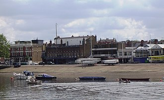 The Championship Course - Boat houses on the river bank near Putney