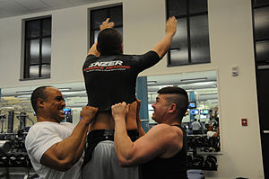 Bench shirt - Powerlifters pulling on a bench shirt.
