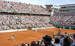 Rafael Nadal prepares to receive Roger Federer...