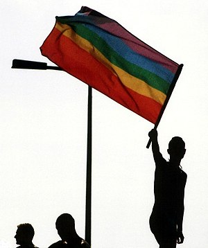 Figure waves rainbow flag during Christopher S...