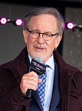 Steven Spielberg shown talking into a microphone
