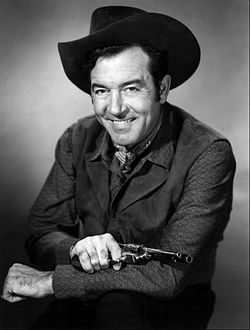 John Payne The Restless Gunin mainoskuvassa 1957.