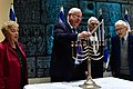 Reuven Rivlin lights a second Hanukkah candle with Holocaust survivors from all over Israel, December 2018 (KBG GPO102).JPG