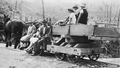 Ride to a picnic at Waituhi on a horse-drawn ballast truck of the Taringamotu Tramway in the late 1920s.png