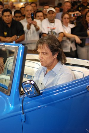 "Roberto Carlos (singer) - Roberto Carlos and his car known as ""Calhambeque"", in 2014."