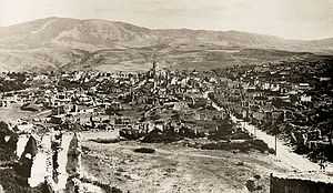 Shusha massacre - Ruins of the Armenian half of Shusha after the city's destruction by Azerbaijani army in March 1920. In the center: defaced Armenian Ghazanchetsots Cathedral