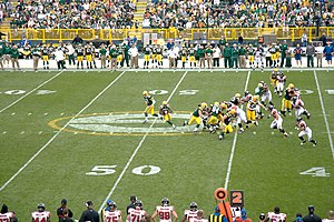 2008 Atlanta Falcons season - Green Bay Packers quarterback Aaron Rodgers hands off to Ryan Grant in Atlanta's week 5 encounter at Lambeau Field