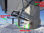 A safety gate at the top terminal detects passengers failing to unload. An open restraining bar is also visible.
