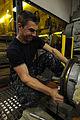 Sailor performs maintenance on generator 121022-N-TL563-112.jpg