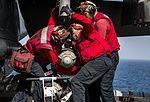 Sailors assigned to USS Dwight D. Eisenhower load ordnance onto an F-A-18E Super Hornet. (29503185123).jpg