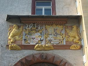 Colditz Castle - Coat of arms of Augustus of Saxony and his wife Anne of Denmark over the gate to the outer courtyard.