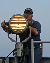 us navy quartermasters have many diverse responsibilities here a us navy quartermaster sends morse code signals in 2005