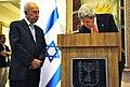 Secretary Kerry Signs Israeli President Peres' Guestbook.jpg