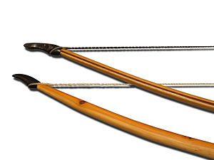 Longbow - Top: Lemonwood, purpleheart and hickory laminated bow.  Bottom: Yew selfbow.