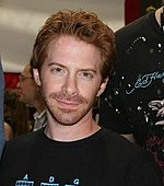 A young man with red hair and stubble
