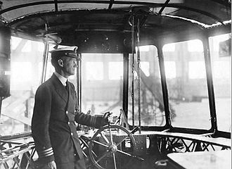 """USS Shenandoah (ZR-1) - 1923 photo of the airship control gondola of the USS Shenandoah. Commander McCrary, the ship's commander, is shown at the wheel. Called """"Empress of the Clouds"""""""