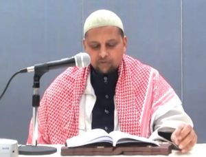 Sheikh - Somali Sheikh Muhammad Dahir Roble reading a Muslim sermon.