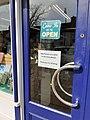 Shop door in Ireland during the 2020 coronavirus pandemic.jpg
